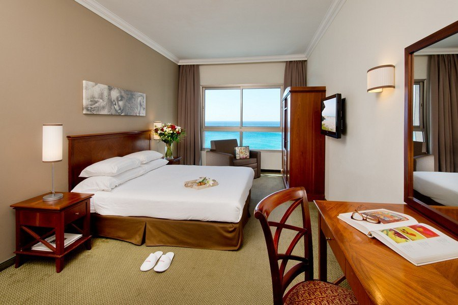 חדר אקסקיוטיב עם נוף לים